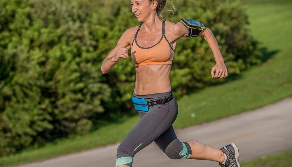 runner with arm band and running belt