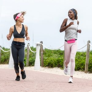 Two woman running wearing Fitletic running belts