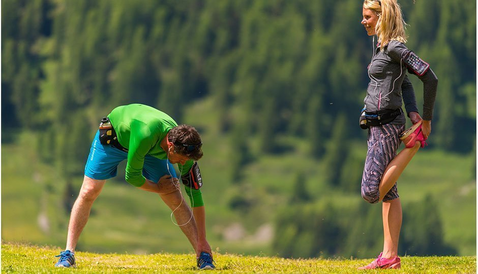 two runners with fitletic gear stretching